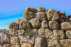 Rock wall at ancient Mycenae archaeological site in the Peloponnese which legend says were built by Cyclops. A Rock wall at ancient Mycenae archaeological site stock image