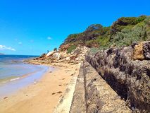 Rock wall. At the beach stock image