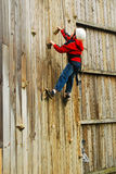 Rock Wall Challenge. A young boy takes the challenge to climb the rock wall Stock Image