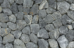 Rock wall. The wall made by rocks Royalty Free Stock Photos