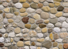 Rock wall of natural river stones. Stonewall masoned with natural river stones Royalty Free Stock Image