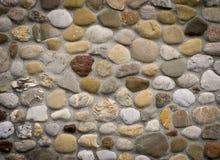 Rock wall of natural river stones. Stonewall masoned with natural river stones Stock Image