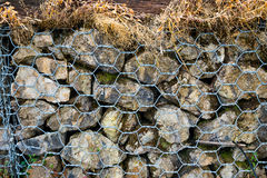 Rock wall. With net steel, Pattern shot Royalty Free Stock Image