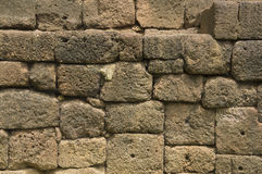 Rock wall old ancient rural brick pattern cement Royalty Free Stock Image