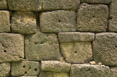 Rock wall old ancient rural brick pattern cement Stock Images