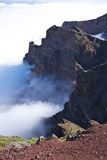 Rock wall over clouds at La Palma Stock Images