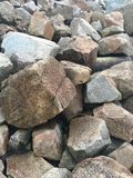 Rock wall. Pile of rocks at the water Stock Photo