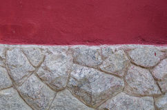 Rock wall with red texture wall. Above Royalty Free Stock Photo