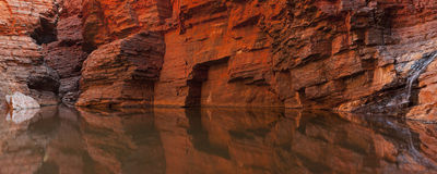 Rock wall reflections in a gorge, Karijini NP, Australia Royalty Free Stock Photography
