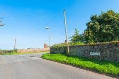 Rock wall by a road. In downtown Spott, Scotland royalty free stock photo