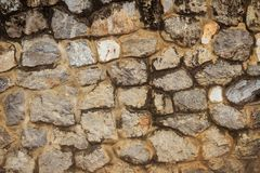 Rock wall seamless texture for background. Decorative uneven cra Stock Photos