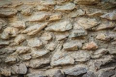 Rock wall seamless texture for background. Decorative uneven cra Stock Image