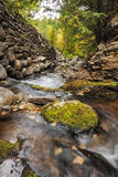 Rock Wall and Stream. Stream running next to a rock wall in Hague New York royalty free stock photos