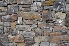 Rock wall texture. Wall made of stones fitted together Royalty Free Stock Images