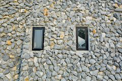 Rock wall with two narrow windows Royalty Free Stock Photos