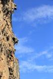 Rock wall under blue sky Stock Photo