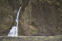 Rock Wall And Waterfall Stock Image