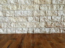 Rock wall and wooden floor Royalty Free Stock Photo