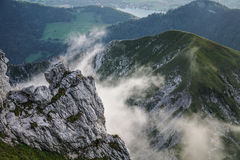 Rock walls - La tournette summit. Rock view with cloud near Annecy - France Royalty Free Stock Photos