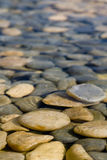Rock in water. Lisabon , rock , water, reflection, nature, calm , mood, peace, view, park, pool, decoration Royalty Free Stock Images