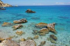 Rock in the water of Agios Nikitas Beach, Lefkada, Ionian Islands Royalty Free Stock Image