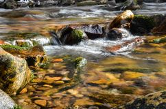 The rock waterfall of a fast flowing river stock photography