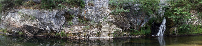 Rock and waterfall Stock Photos
