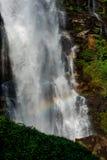 Rock waterfall rainbow Stock Photography