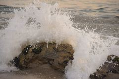Wave in malibu beach sunset time. Rock ,wave in malibu beach sunset time  have good day Stock Photography