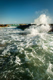 Rock and waves in the sea Royalty Free Stock Photos