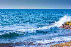Rock and waves in sea Royalty Free Stock Photo