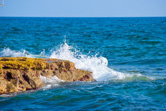 Rock and waves in sea Stock Photography