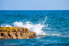Rock and waves in sea Royalty Free Stock Photography