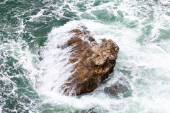 Rock and waves Royalty Free Stock Photo