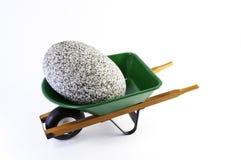 Rock in wheel barrel Royalty Free Stock Photo