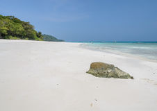 Rock on white sand beach of Tachai island, Thailand Royalty Free Stock Photo