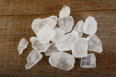 Rock white sugar on wooden background Royalty Free Stock Images