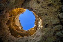 Rock window Atlantic Ocean,the province of Algarve, Portugal Stock Photos