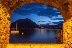 Rock Window Over Tranquil Lake Como At Dusk Stock Image