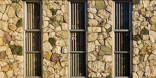 Rock Windows Wall. Wonderful to look at how theses rocks a fitted together, to make a wall with windows Royalty Free Stock Image