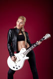 Rock woman in black leather posing whit guitar Royalty Free Stock Photo