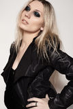 Rock woman in fashion leather jacket with dark evening make-up Royalty Free Stock Photography