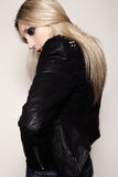 Rock woman in fashion leather jacket with dark evening make-up royalty free stock images