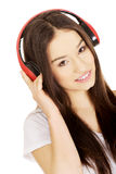 Rock woman with headphones listening to music. Royalty Free Stock Images