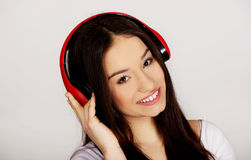 Rock woman with headphones listening to music. Royalty Free Stock Photos
