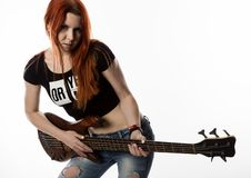 Rock woman playing on electric guitar on a white background. stock photography