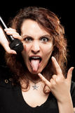Rock Woman Singer. Sticking Out Her Tongue and Making the Sign of Horns stock image