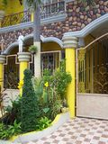 Rock work of yellow home entrance Stock Photos