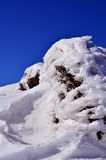 Rock. Wrapped in snow and ice Royalty Free Stock Photos