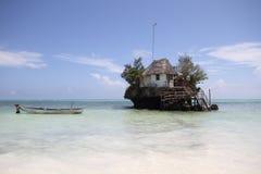 The Rock Zanzibar. The Rock restaurant Zanzibar Tanzania during high tide Stock Image